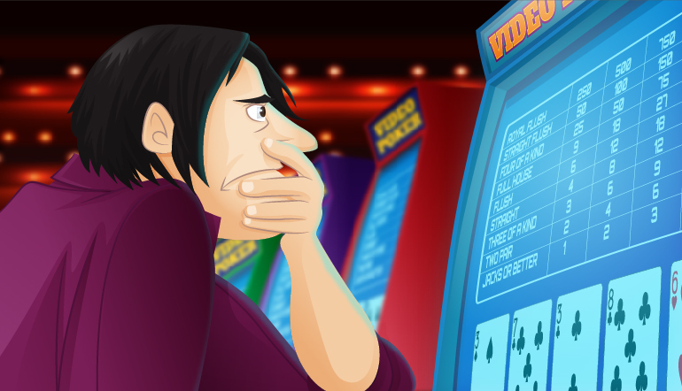 Frowning video poker player with a low pair of cards showing on the machine